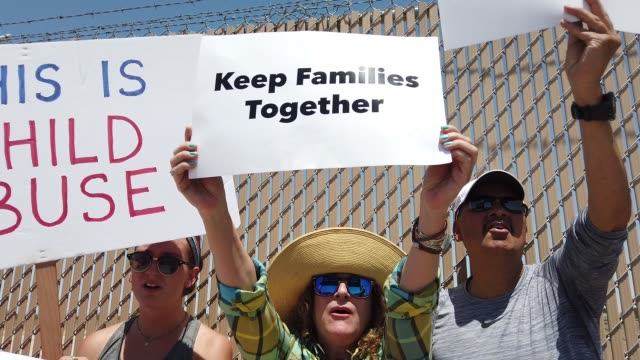protesters demonstrate in front of the u.s. border patrol facility where lawyers reported that detained migrant children were held unbathed and... - einwanderer stock-videos und b-roll-filmmaterial