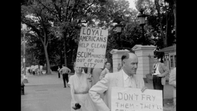 protesters demonstrate in front of the white house about the rosenberg's death decision. julius and ethel rosenberg were american citizens who were... - united states and (politics or government) stock videos & royalty-free footage
