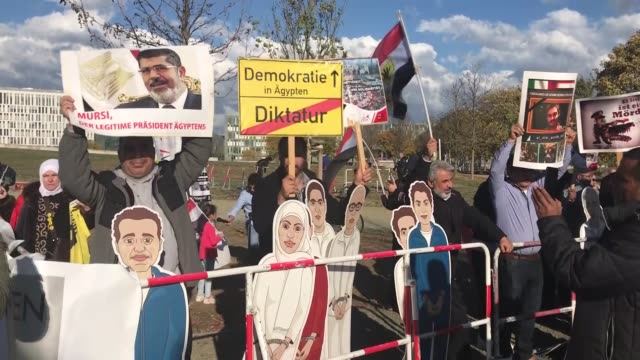 protesters demonstrate outside the chancellery in berlin against egyptian president abdel fattah alsisi during his meeting with german chancellor... - president of egypt stock videos & royalty-free footage