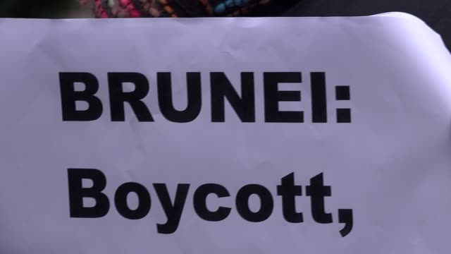 protesters demonstrate outside the dorchester hotel against brunei's anti-lgbt laws; uk, london: protesters demonstrate outside the dorchester hotel... - brunei stock videos & royalty-free footage