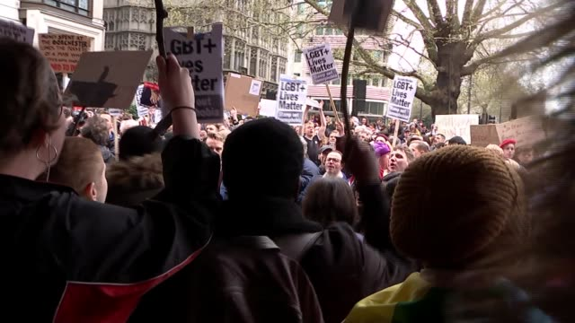 protesters demonstrate outside the dorchester hotel against brunei's anti-lgbt laws; england: london: park lane: dorchester hotel: ext protester... - brunei stock videos & royalty-free footage