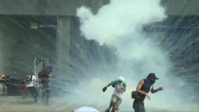 Protesters destroy part of façade of Venezuela's Supreme Court offices as violent clashes break out on Saturday between demonstrators and police...