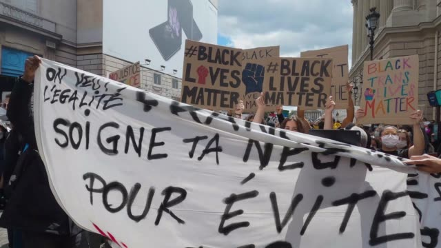 protesters display anti racist and black lives matter signs as protesters gather during a demonstration against racism and police brutality near the... - france stock videos & royalty-free footage