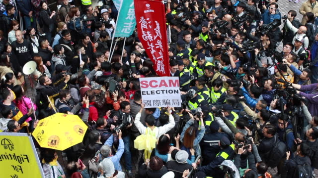 Protesters displeased about a Beijingcontrolled election outside the venue of 2017 Hong Kong Chief Executive election in Hong Kong