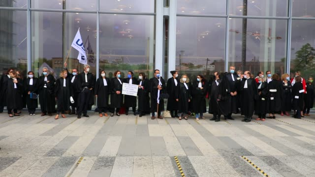 protesters dressed in lawyers during a demonstration called by the two main magistrates unions, the union syndicale de la magistrature and the... - supreme court justice stock videos & royalty-free footage