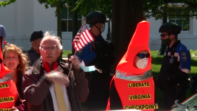 protesters drive and 'honk horns' in state capital, richmond, demanding virginia be reopened during coronavirus crisis - バージニア州 リッチモンド点の映像素材/bロール