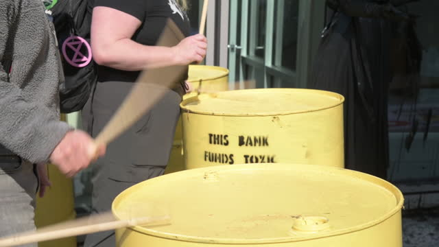 protesters drumming on yellow oil barrels during march on wells fargo bank branches in downtown washington to protest the bank's funding of the... - drum percussion instrument stock videos & royalty-free footage