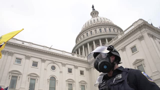 protesters face off with police outside at the u.s. capitol building on january 06, 2021 in washington, dc. pro-trump protesters entered the u.s.... - capitol hill stock videos & royalty-free footage
