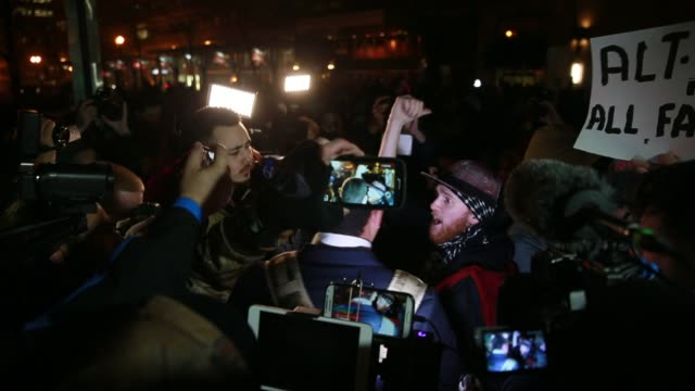 Protesters fill the street in front of the National Press Club to protest against members of the altRight who were staging a preinaugural ball called...