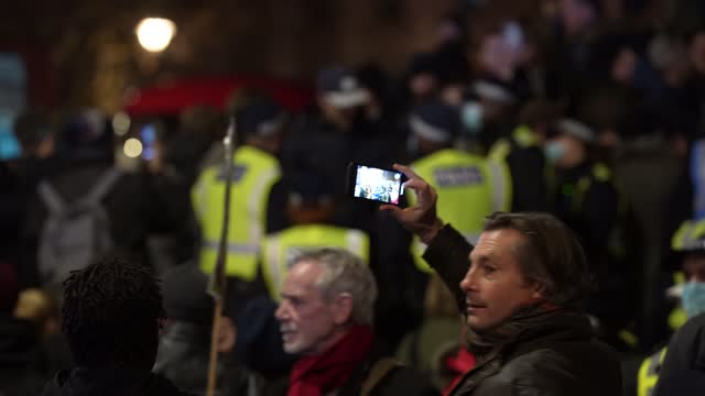 protesters film on their smartphones during the million masked march in central london on november 5, 2020 in london, england. decentralised,... - protestor stock videos & royalty-free footage