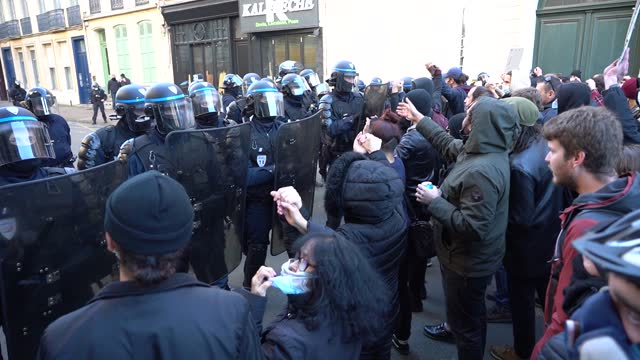 protesters form a human chain in front of police riot members during a second protest on november 28, 2020 in lille, france. the march, called by... - france stock videos & royalty-free footage