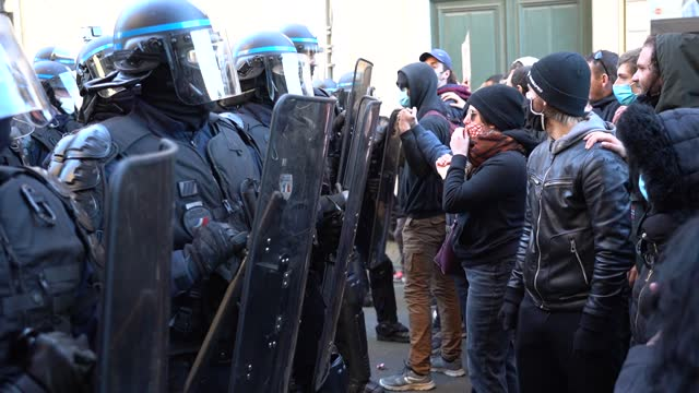 protesters form a human chain in front of police riot members during a second protest on november 28, 2020 in lille, france. the march, called by... - law stock videos & royalty-free footage