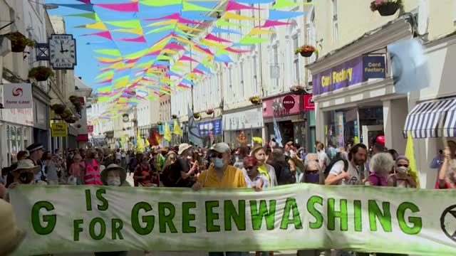 protesters from climate activist group extinction rebellion march through the streets of falmouth, southwest england, waving flags and holding signs... - ecosystem stock videos & royalty-free footage