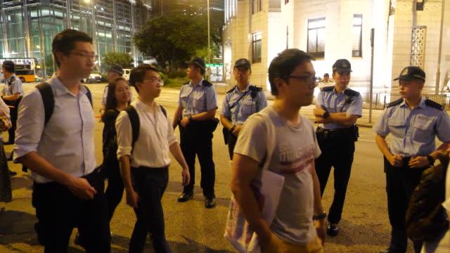 vídeos de stock, filmes e b-roll de protesters gather at charter garden in the central district of hong kong - ilha de hong kong