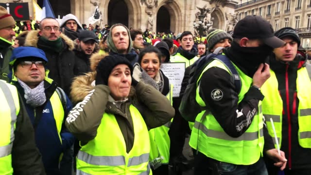 Protesters gather at Place de l' Opera during the 'yellow vests' demonstration on December 15 2018 in Paris France ''Yellow Vests' is a protest...