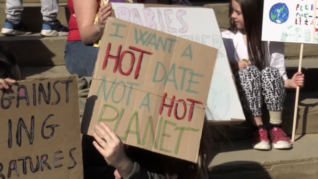 protesters gather at st george's hall, liverpool to take part in the global climate strike. people have taken to the streets across the uk as part of... - strike protest action stock videos & royalty-free footage