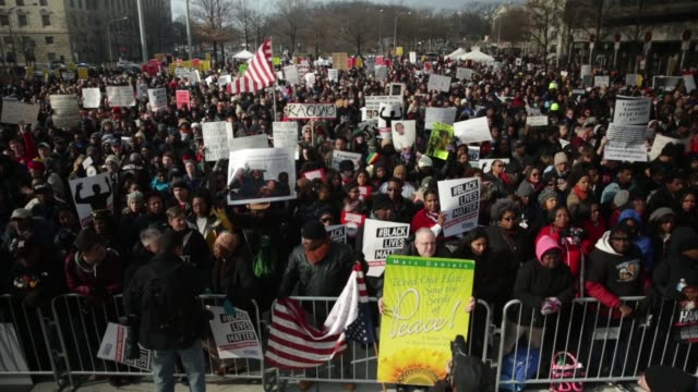 protesters gather at the freedom plaza for the premarch rally december 13 washington dc thousands of people gather in the nation's capital for the... - freedom plaza video stock e b–roll