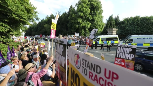 protesters gather at the gates of blenheim palace where u.s. president donald trump is attending an evening function in woodstock on july 12, 2018 in... - oxfordshire stock videos & royalty-free footage