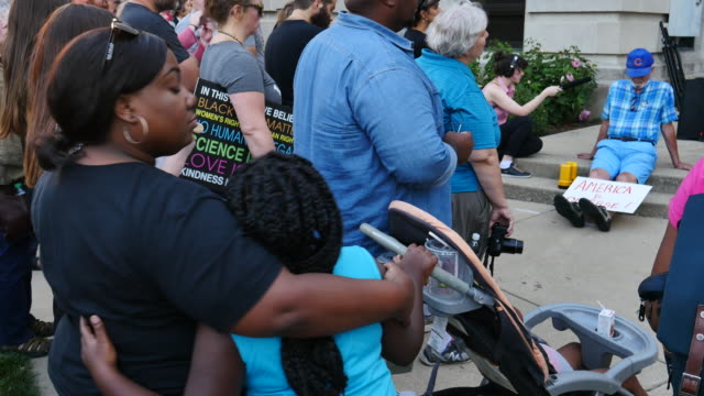 Protesters gather at the Monroe County Courthouse in Bloomington Ind for a Sunday August 13th protest vigil in solidarity after the violence between...