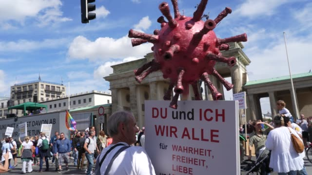 protesters gather at the victory column in the city center to hear speeches against coronavirus-related restrictions and government policies on... - berlin stock videos & royalty-free footage