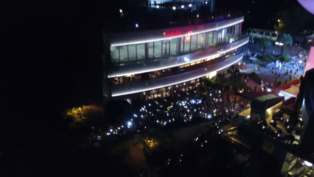 stockvideo's en b-roll-footage met protesters gather at victoria peak for a nighttime protest shining lights and laser pointers - victoria peak