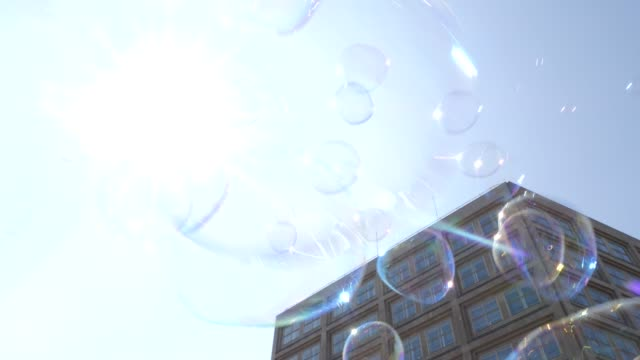 """protesters gather before the start of the demonstration at alexanderplatz, a man creates huge bubbles protesters take part in the """"one europe for... - populism stock videos & royalty-free footage"""