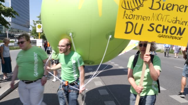 """protesters gather before the start of the demonstration at alexanderplatz. protesters take part in the """"one europe for all"""" march on may 19, 2019 in... - greenpeace stock videos & royalty-free footage"""