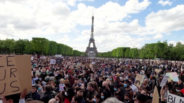 protesters gather during a demonstration against racism and police brutality on the champs de mars on june 06, 2020 in paris, france. demonstrators... - france stock videos & royalty-free footage