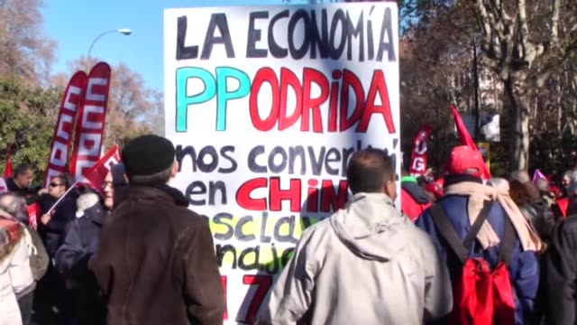 vídeos de stock e filmes b-roll de protesters gather during an antigovernment demonstration organized by the general workers' union of spain and spain's workers' commissions in support... - desemprego