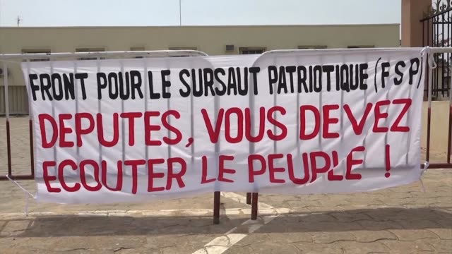 protesters gather in front of benin's parliament to denounce a plan for a constitutional amendment which would see a single term presidency - benin stock videos and b-roll footage