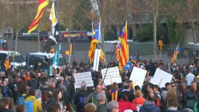 protesters gather in front of fc barcelona's camp nou stadium ahead of their la liga game against real madrid answering a call from pro independence... - independence stock videos & royalty-free footage