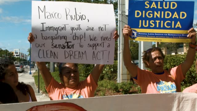 protesters gather in front of the offices of sen marco rubio to ask him to help recipients of the deferred action for childhood arrivals on january... - doral stock videos and b-roll footage
