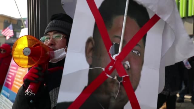 protesters gather in pyeongchang as north korean leader kim jong un's sister arrives the first member of pyongyang's ruling dynasty to set foot in... - korean war stock videos and b-roll footage