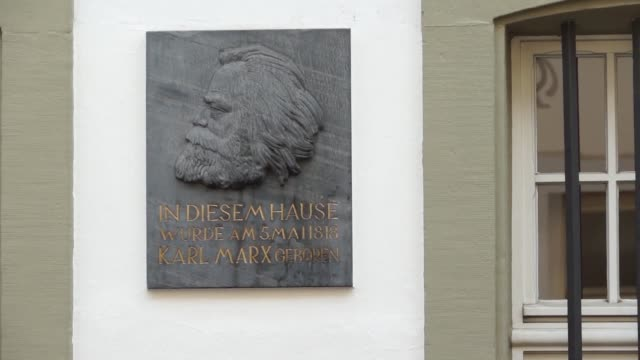 Protesters gather in Trier Germany to demonstrate against the inauguration of a statue of Karl Marx whilst his supporters celebrate 200 years since...