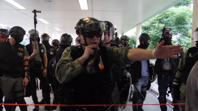vídeos de stock, filmes e b-roll de protesters gather in wan chai where police fired tear gas to disperse the crowd - wan chai