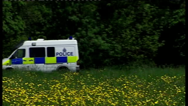 protesters gather near research centre where gm wheat crop is being grown england hertfordshire harpenden rothamsted research centre ext police vans... - bukettranunkel bildbanksvideor och videomaterial från bakom kulisserna