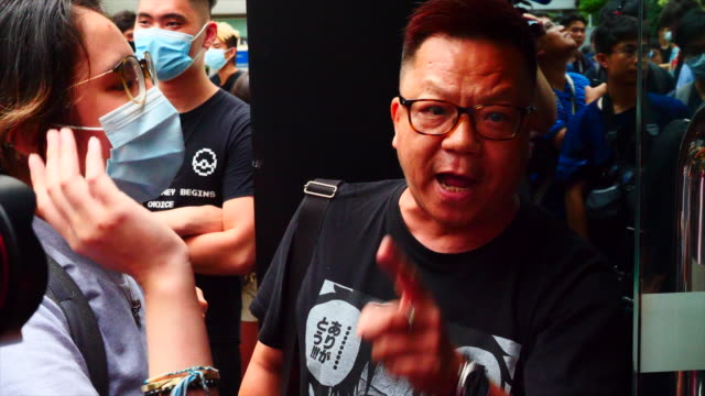 protesters gather near the central government complex as a group occupies the lobby of the revenue tower preventing people from paying taxes and... - obscene gesture stock videos and b-roll footage