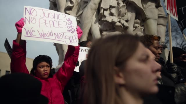 protesters gather on capitol hill for the postmarch rally december 13 washington dc thousands of people gather in the nation's capital for the... - police brutality stock videos and b-roll footage