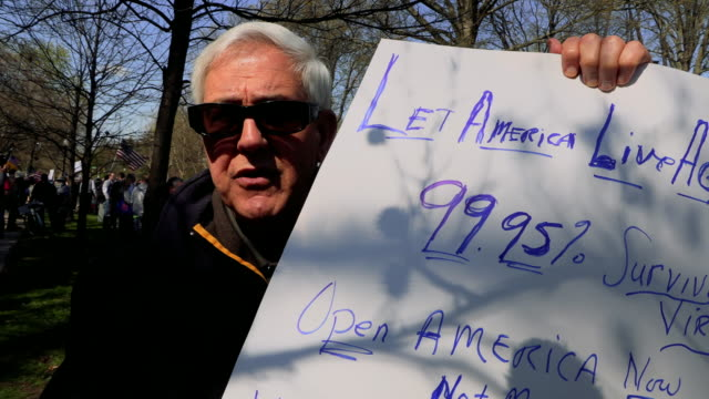 protesters gather outside indiana governor eric holcomb's mansion in the 4700 block of n. meridian street, to protest what they are describing as,... - home economics点の映像素材/bロール