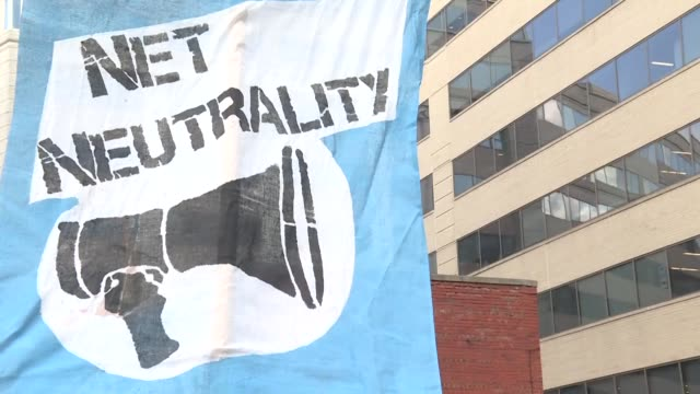 Protesters gather outside the Federal Communications Commission as the government body votes to roll back so called net neutrality rules that require...