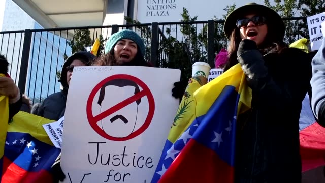 vídeos de stock, filmes e b-roll de protesters gather outside the united nations as the security council holds a special session on the situation in venezuela where opposition leader... - atlântico central eua