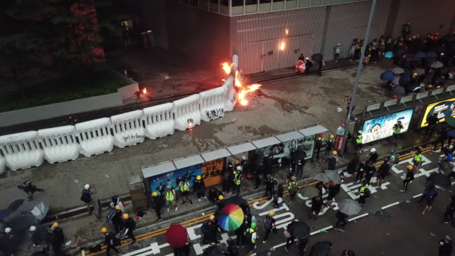 protesters gathered and blocked harcourt road near government complex and threw molotov cocktails and bricks at police who fired tear gas and water... - molotov cocktail stock videos and b-roll footage