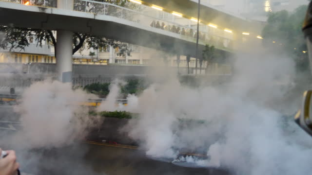 protesters gathered and blocked harcourt road near government complex and threw molotov cocktails and bricks at police who fired tear gas and water... - water cannon stock videos & royalty-free footage
