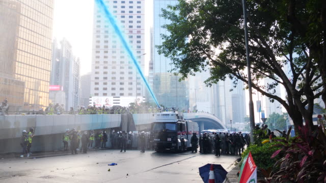 protesters gathered and blocked harcourt road near government complex and threw molotov cocktails and bricks at police who fired tear gas and water... - cannon stock videos & royalty-free footage