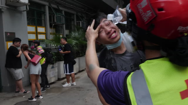 protesters gathered and blocked harcourt road near government complex and threw molotov cocktails and bricks at police who fired tear gas and water... - demonstrant stock-videos und b-roll-filmmaterial