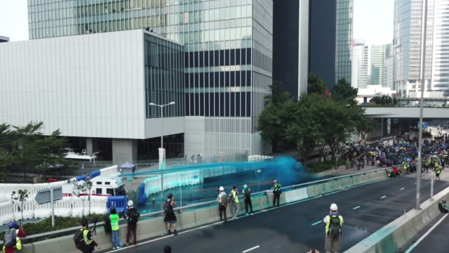 protesters gathered and blocked harcourt road near government complex and threw molotov cocktails and bricks at police who fired tear gas and water... - cannone video stock e b–roll