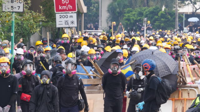 Protesters gathered at Tsun Yip Street Playground and had a peaceful marched across Kwun Tong The more radical groups of protesters stop near the...