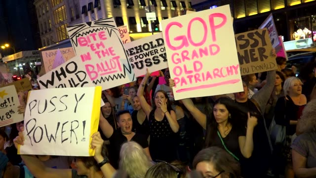 """protesters gathered outside of trump tower on 5th avenue and dubbed the protest """"pussy power at trump tower"""" in opposition of donald trump's... - 2016 united states presidential election stock videos & royalty-free footage"""