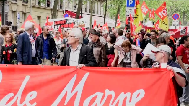 protesters gesture and hold a banner as general confederation of labour commences their 8th widespread protests all around the france for protesting... - rennes frankreich stock-videos und b-roll-filmmaterial
