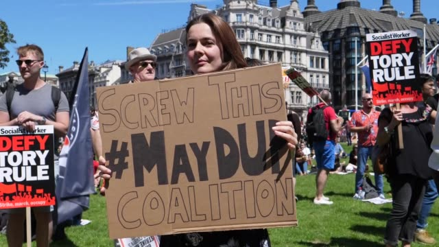 protesters held a rally calling for the resignation of british prime minister theresa may and against forming a coalition government with the... - prime minister of the united kingdom stock videos & royalty-free footage